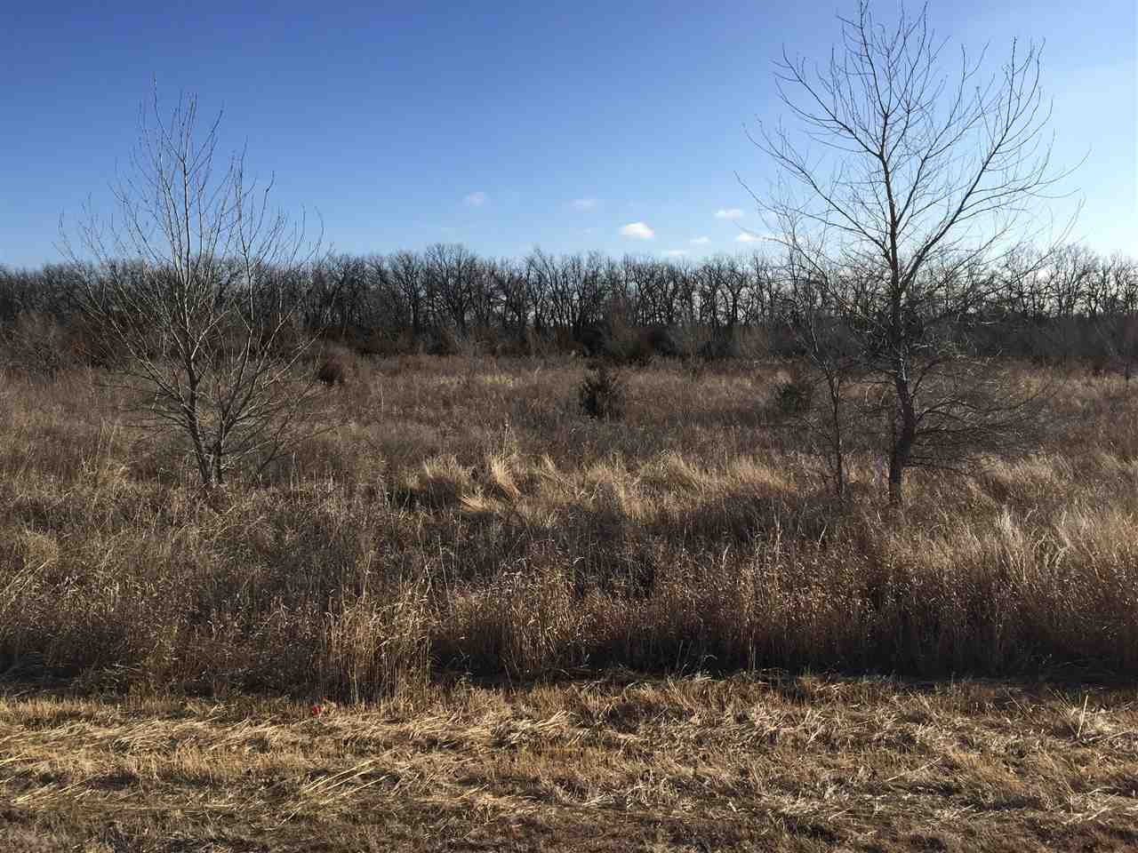 2.2 Acre home site in the prestigious Flint Hills National nationally ranked golf course community.  East facing backyard overlooks common area with lots of trees and privacy.  Minimum main level square footage is 2,500 sq.ft. The front exposure overlooks one of the many stocked ponds in Flint Hills National were there is additional common area.  Gorgeous lot with gorgeous views!