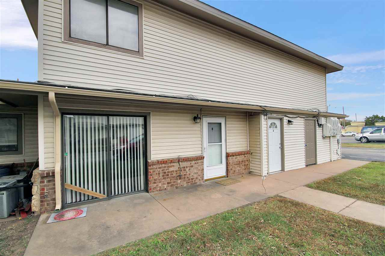 Come check out this adorable 2 bed 1 bath condo.  Includes all appliances, even washer and dryer.  It even has a one car attached garage with opener. Lots of storage closets.  The outside is currently being upgraded with a new roof, new paint and new gutters.   Great location on the west side, close to restaurants and shopping.  This is perfect for a first time home buyer or an investor don't miss out on this one!!!  HOA takes care of water and trash removal.