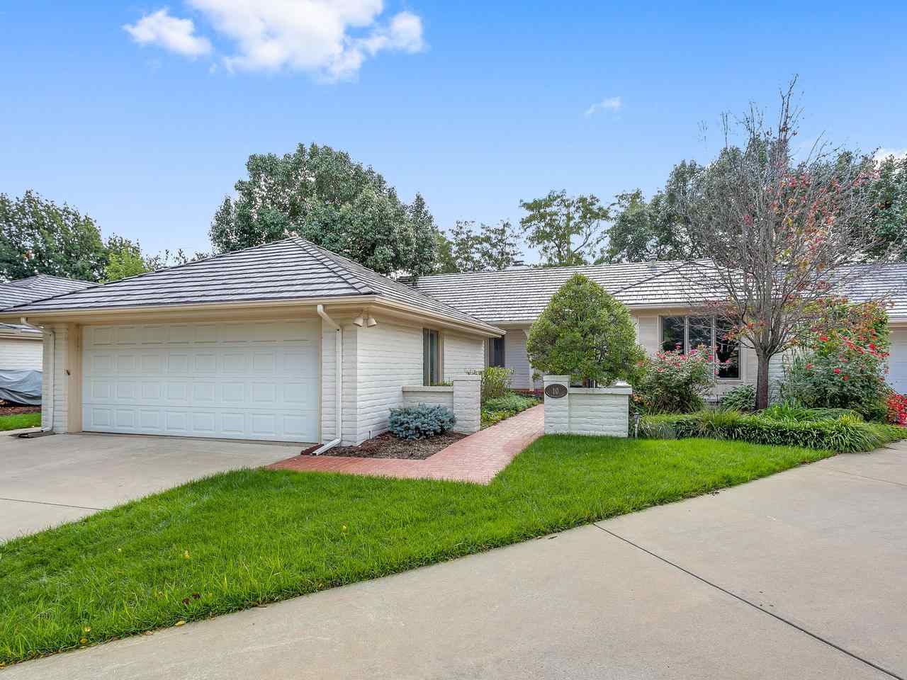 "$15K PRICE REDUCTION....SELLER WANTS SOLD!  Welcome home to the fabulous area of The Greens.  This patio home has all new paint and carpet through out!  Lovely grey tone with white trim as well as the happiest shade of green in the kitchen and bedrooms.  Very nice floor plan excellent for entertaining.  13x10 nook off the living room with built in bookcase is the perfect area for a study (marked as office on dimensions) or TV den.  Main floor master has walk in closet with built in drawers.  Make up vanity between bedroom and closet near the master bath. Main floor powder room for your guests. Basement has 2nd bedroom with attached full bath.  Large family room and two storage areas.  Lovely 29x10 covered brick patio in back and gorgeous landscaping. 3 year old Class 4 tile roof (could be a savings on insurance). Additional common parking for guests.  HOA dues cover lawn care, sprinkler maintenance & water use, snow removal for 2"" or greater, trash service, security, mail boxes, trimming of front bushes & maintenance of the commons areas. Annual fee of $1213 and then $310 per month.  Don't delay, these units don't come up for sale very often."