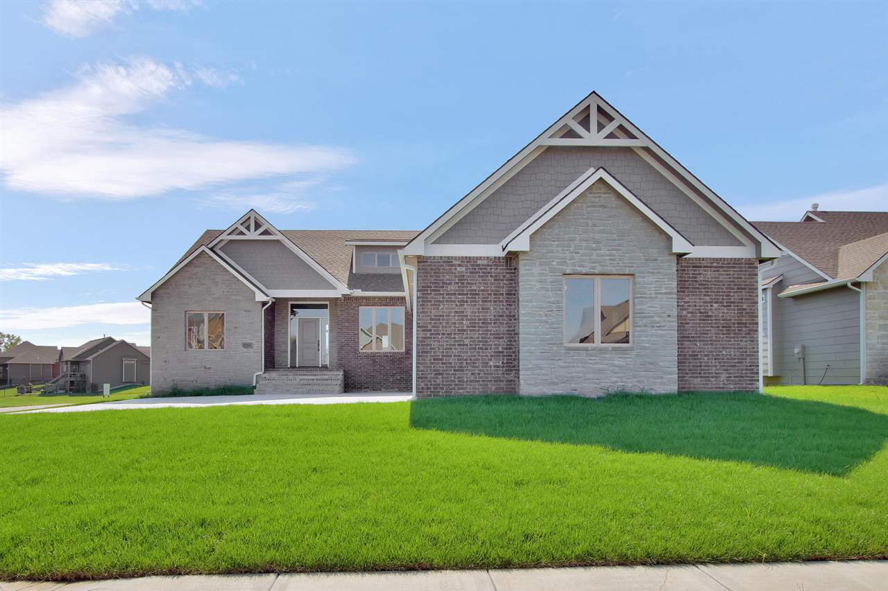 Builder has chosen lots of upgrades with tile, granite counter-tops, wood beams, 9ft ceilings in basement, over-sized garage, lake, golf course lot, only approx 10k in total specials remain compared to other subdivisions that have between $30,000 to $40,000 in total specials.  Sprinkler system, sod and irrigation well included.  OPEN SATURDAY AND SUNDAY 1-4 PM. MODEL HOME IS LOCATED AT 2313 S IRONSTONE CT.