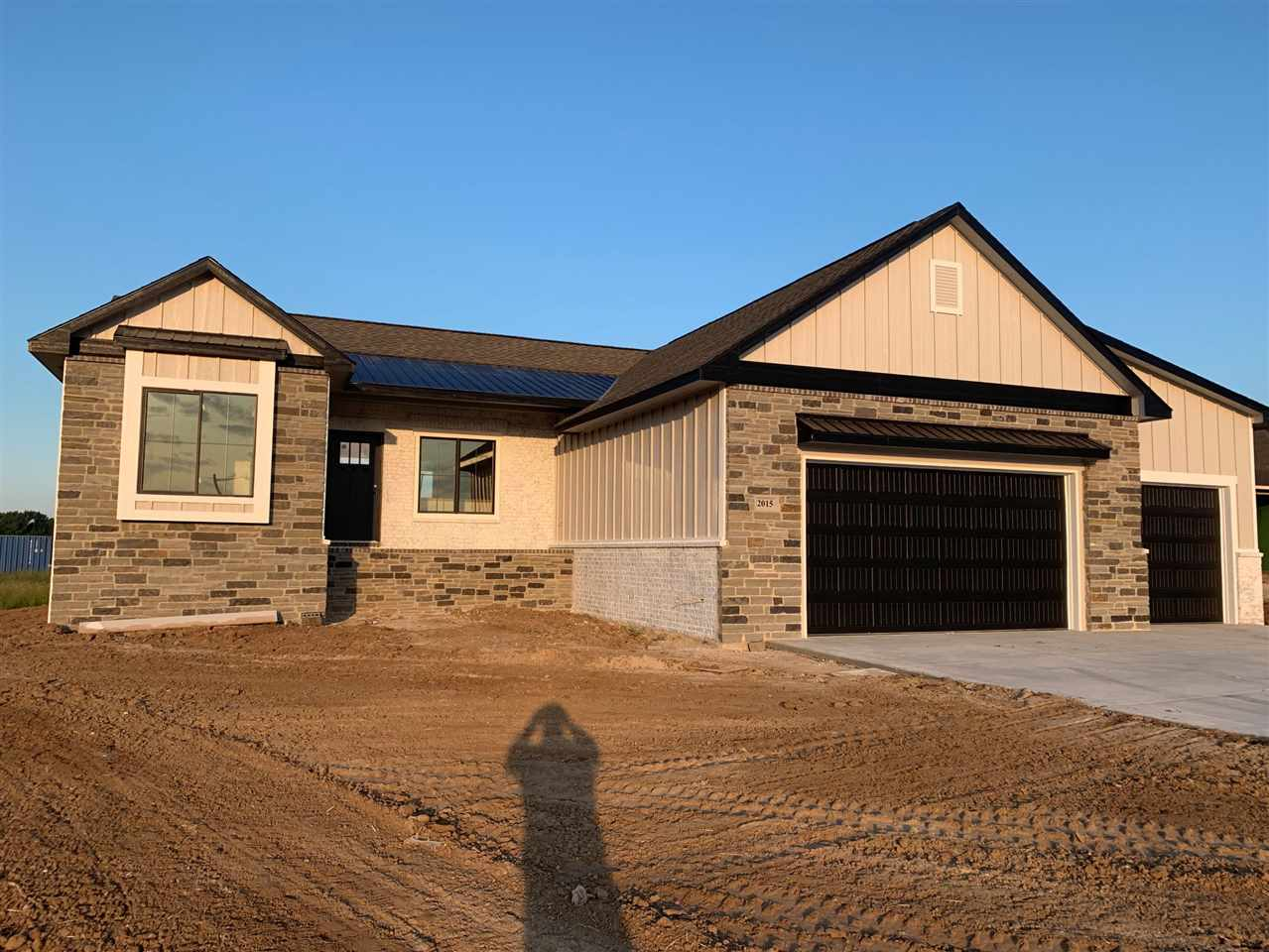 Come see the latest and greatest home in Elk Ridge from Woods Homes!  This modern craftsman brings e