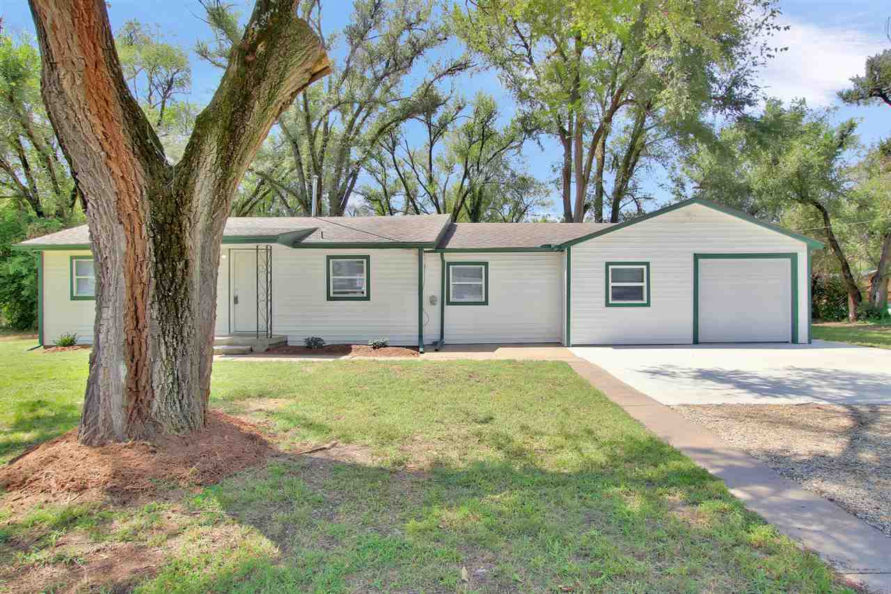On OVER 1/2-acre, this home is **NEWLY REMODELED** You will not find a nicer home in the area. 3 Bedrooms with roomy closets and 1 FULL / 1 HALF BATH. **ALL NEW ELECTRICAL, PLUMBING, WELL, & SEWER LINE**LOW MAINTENANCE VINYL SIDING**The main living room is HUGE with an open concept to the kitchen, and a separate LARGE formal dining room that can also be used as a family room or play space! **NEW CARPET throughout & WOOD FLOORING**This GORGEOUS kitchen holds an eat-up island, NEW CABINETS, NEW COUNTERTOPS, NEW STAINLESS STEEL APPLIANCES ~ ALL WHICH REMAIN!! Separate Main floor laundry room is spacious with tile floors, and has NEW CABINET STORAGE with an adjacent 1/2 bath. Backyard has plenty of entertaining space and beautiful mature trees.    Take a look at the extensive list of updates & upgrades that have been carefully done to this home; there is simply nothing left to do but MOVE IN!  You'd better call NOW FOR A PRIVATE SHOWING . . .