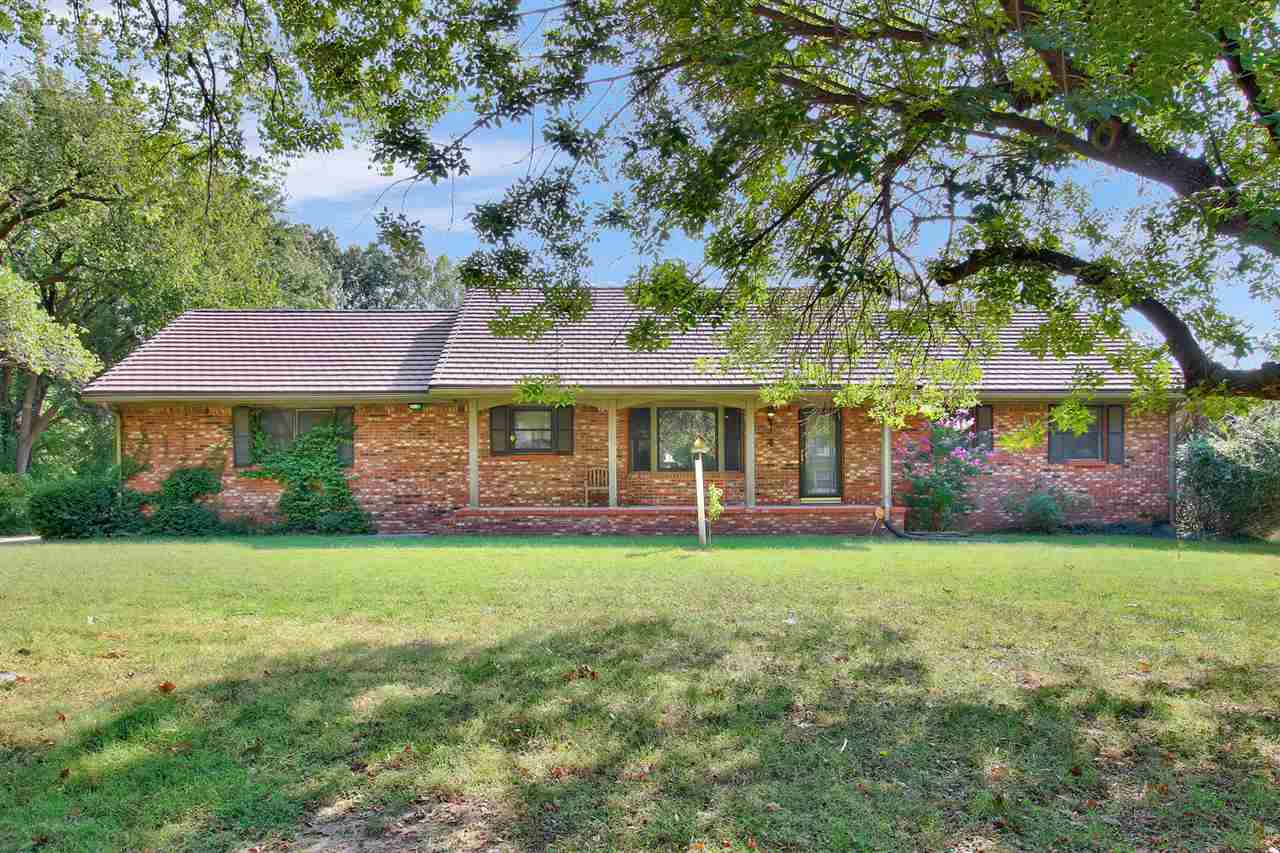 This is THE home you've been waiting for! This amazing, all brick home is located on a quiet, seclud