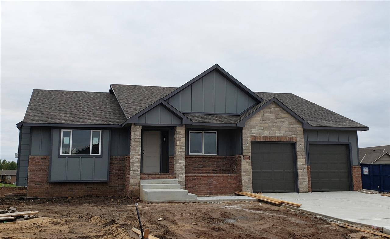 Beautiful new construction walk-out walk-up ranch home by Relph Construction in Whispering Lakes, backs up to tree row! Huge 4 car tandem garage could fit 4 compact cars, or could hold a boat and trailer. Granite or quartz on all counter tops, open floor plan, hidden walk-in pantry, basement wet bar, and a covered deck over a walk-out patio. Master bath has huge shower room with seat, and a full wall of storage. Price includes irrigation well, sprinkler system and landscaping! Low traffic in secluded neighborhood with community pool, and nature tails with three lakes to enjoy, fishing, but close to HWY 96 or Andover Dillon's Marketplace and YMCA.