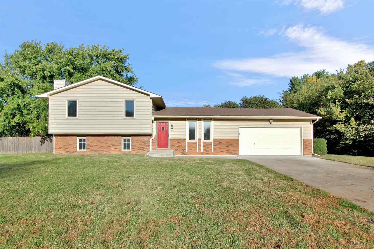 OPEN SUNDAY 12/1 2-4pm   Back on the market! Small town living!  Cute 3 bed, 2 bath split level home in Rose Hill that sits on a large (.42 acre) corner lot.  Ready to move in - neutral decor.  Bathrooms have been remodeled and the master bath has a walk in shower!  The family room in the lower level has all new flooring, lots of natural light and a new dry bar area.  Oversized garage, brand new patio in the large, privacy fenced yard.  Don't miss out!