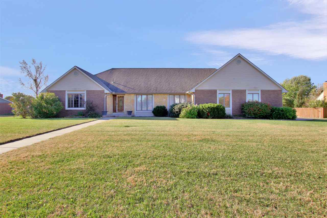 This home has it all!! This immaculately maintained 4 bedroom, 3 1/2 bathroom home is ready for you! As you drive up to the home you will notice a side load 3 car garage as well as a huge DETACHED GARAGE/WORKSHOP that could hold several vehicles. As you enter the home, you will see wide open spaces, tons of natural light and a lot of square footage to hold family gatherings and parties. The main level includes a large formal living room, dining room that is open to the kitchen, a large main floor laundry room and an additional 1/2 bathroom for guests to use. The huge master is an oasis with large windows and a master bathroom with separate jetted tub and shower. There are two additional bedrooms and a bathroom for your children or guests. The full finished basement has stained concrete floors, a huge family room, large wet bar and tiered theater room! This space is perfect for spending time with family. The basement also had one additional bedroom, one full bathroom and one non-conforming room with walk-in closet that could be used for a play room or an office. The outdoor space will blow you away! It has an INGROUND POOL, hot tub, basketball / volleyball court all on 3/4 of an acre. The 1500 (50x30) sf DETACHED GARAGE/WORKSHOP has heating and air, an exercise room with a sauna (negotiable), an additional finished space with tanning bed (that stays with the home) and a large attic for additional storage.  There is also a sunken courtyard that is great for entertaining.  There are multiple fruit trees on the property as well. This home is perfect for a family or a person that loves to entertain. Call today to schedule your showing!