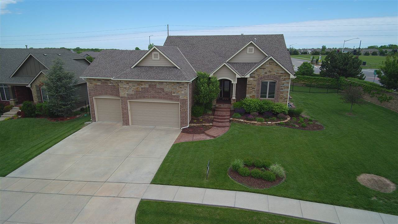 NO SPECIAL TAXES!!!!!!  Amazing Former Model on a Corner Lot in The Oaks Golf Community!  Lush Landscaping on a Sprinkler System on a Well!  Front walk way of stained and stamped concrete leads to a covered Front Porch, walks into inviting Foyer.  Hardwoods throughout.  Open Floor Plan with Fireplace, Built-ins Opens to Island Kitchen with Grand Granite Island, Dining Space and Walk in Pantry.  Spacious Laundry Room with tons of Storage and Cabinets.  Back Patio Area of stamped and stained concrete.  Finished Garage with Sheet rook, Insulation trim and ceiling fans.  Master suite has access to the large covered Composite deck.  Full Finished Walk out Basement has 2nd Fireplace, Entertaining Wet Bar and Room for a 6th Bedroom!!!