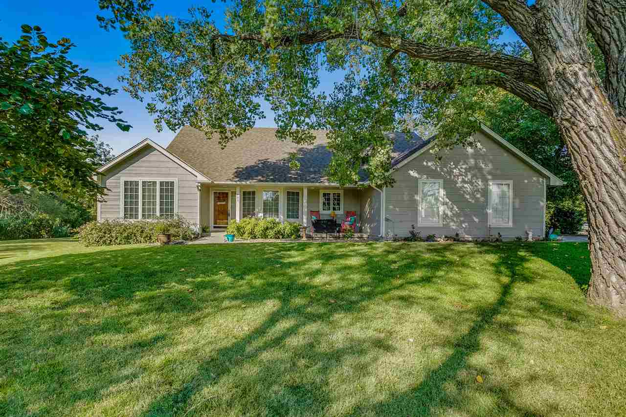 Great Ranch on a Large Wooded Creek Lot!  New Flooring throughout.  3 bedrooms plus a sunroom/office.  Tons of Built-ins including a desk and china cabinet.  Garage has a Concrete Storm Shelter.  8 FOOT PRIVACY FENCE GOING UP!!  BRAND NEW ROOF just installed 11/19 3 days prior to closing buyer got laid off.