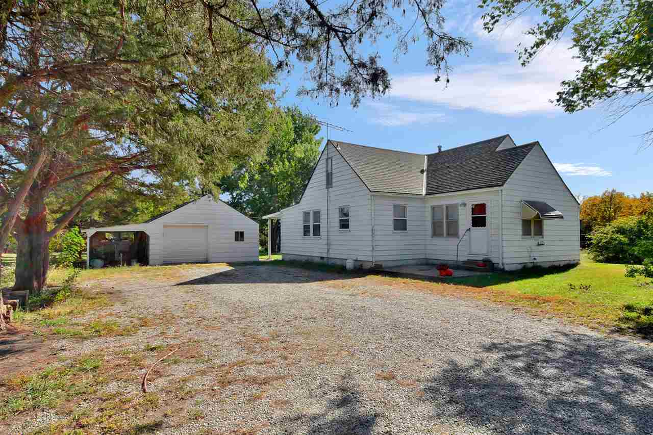 Dream come true! Old farm house nestled on 10.44 acres with an abundance of mature trees, over-sized 2 car garage and another detached building. Lots of wildlife, peace and quiet.