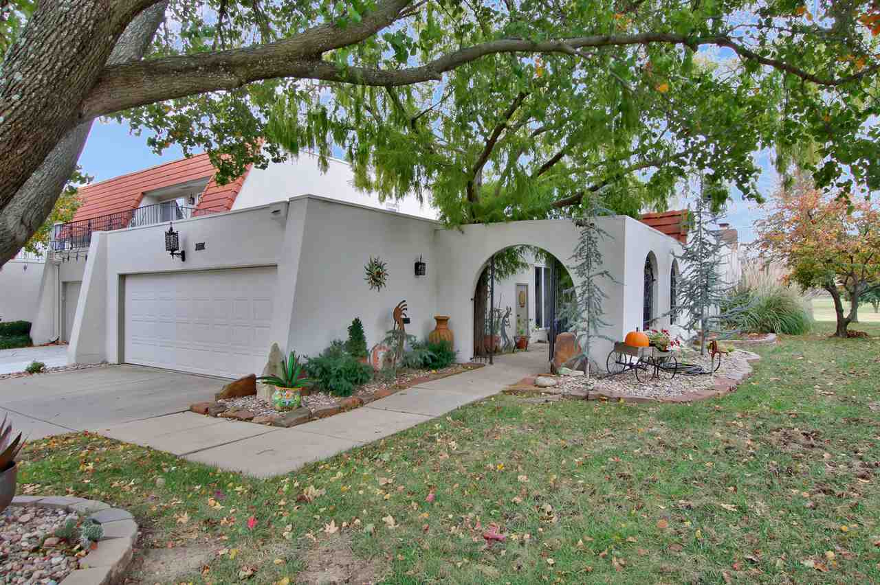 "Another terrific opportunity for an updated one-story end unit with stunning golf and lake views.  Updates include wood floors, wrought iron banister, skylight, newer appliances, tile floors in entry, hallway and kitchen, can lighting, newer plumbing fixtures.   Ceiling support added by previous owner.  Main floor, at almost 2000 square feet, features a very open dining/living combination with beautiful wood floors, kiva fireplace, French doors to the patio and the kitchen which overlooks those living spaces.  Master suite also has French doors to the patio, closet space for all seasons, shoe closet, low profile shower, updated counters and sinks and a vanity area.  There is also a second bedroom on the main floor overlooking the courtyard with a hallway bath.  Nearby you'll also find the main floor laundry.  Basement offers a family/rec room with woodburning fireplace and a finished bonus room.  HVAC and sump pump are fairly new.  Great off-street parking available unlike so many other communities.  Villas I dues cover exterior maintenance, mowing, sprinkling, trimming, snow removal, water, trash and access to the pool and sport court.  Billed quarterly, along with dues, there's a quarterly $358.69 fee for exterior insurance.  Homeowners then only secure ""condo"" insurance for the interior.  You deserve the easy lifestyle The Villas has to offer.  Call for a private showing today!"