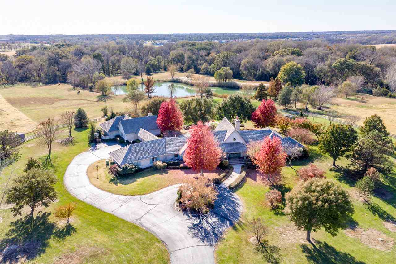 One of a kind opportunity to own a little paradise in town!! This amazing country home comes with 18