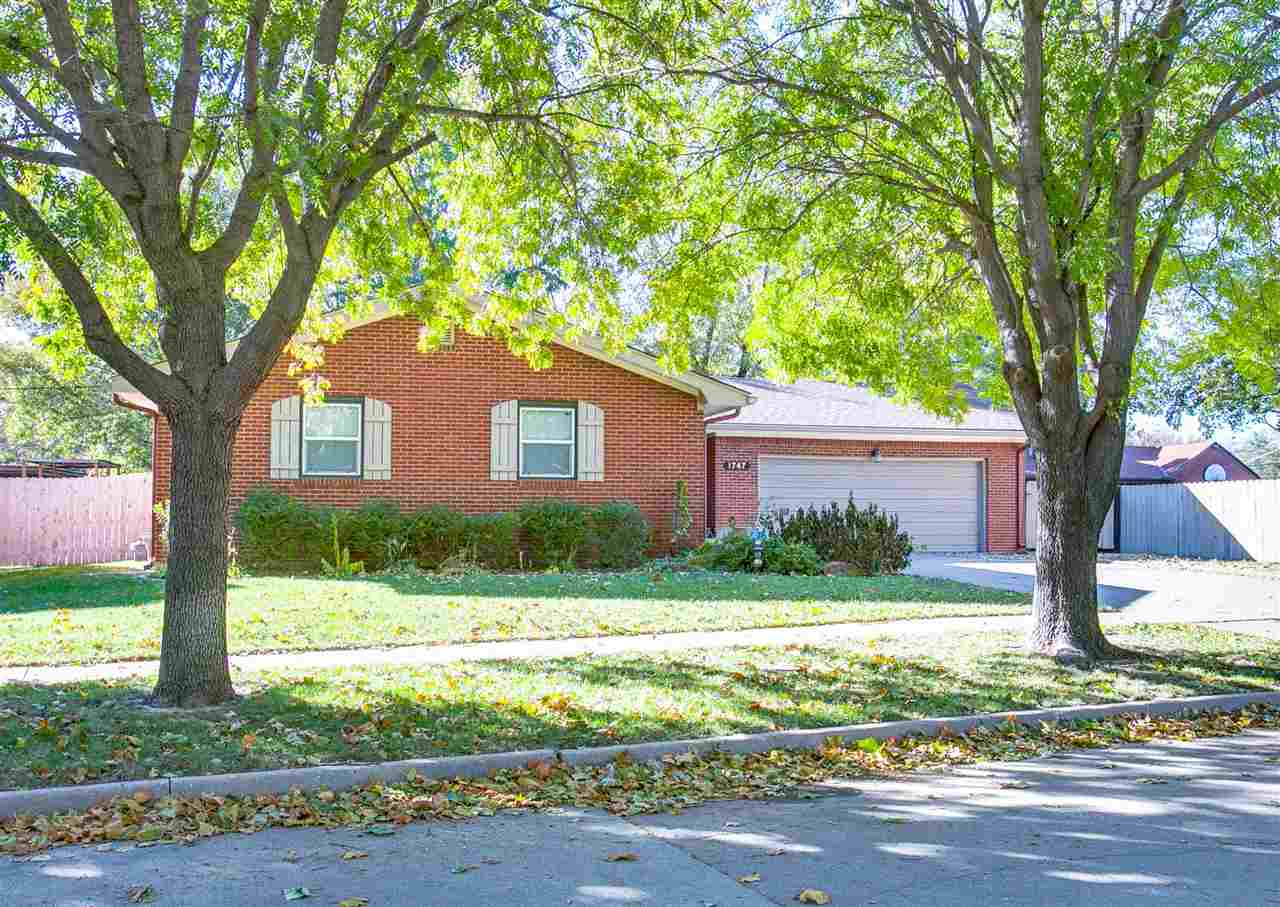 Step into this spacious four bedroom home with a lot of extras. You will love what you see here. This full brick home is just minutes away from shopping, parks and schools. Beautiful mature trees cover the neighborhood. The kitchen features a nice sized eating bar, tile floor, and a partially opened floor plan that leads to the dining area. It has an open railing leads to the basement. The large living area on the main floor is very inviting. And just down the hall is the master bedroom which has an attached master. Across the way are two bedrooms and a hall bath. The basement features a huge rec/living room with new flooring. It also has one bedroom, a bonus room, full bath and laundry area with a large area for storage. The outside of the home has full brick, a small area for boat or RV storage and a cozy fenced in back yard. Don't wait to see this home…..