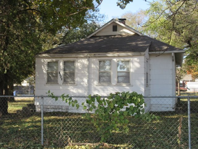 3 bedroom, 1 bath home on quiet neighborhood street. Refrigerator, dishwasher and range/oven remain with home.  Fenced yard with mature trees.  Great for rental or first time home buyer