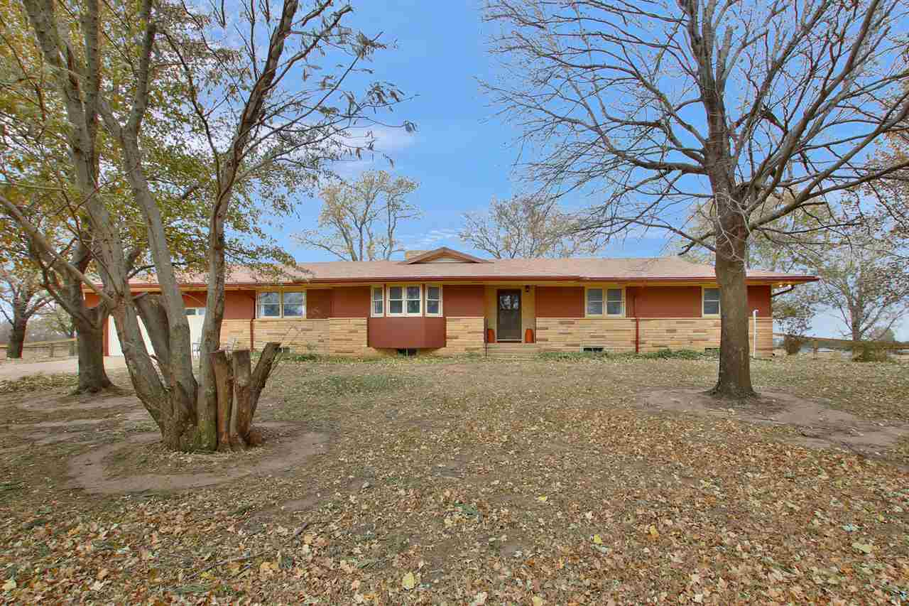 WELCOME HOME to this charming, remodeled, move-In ready home, In sought after Cheney school District! The country charm is hard to miss as you drive up to this 3 bedroom/3bath, 3,000 square foot home that sits on 9.10 acres, in Kingman County. There are even 2'bonus rooms' that could be used for additional bedrooms if needed! You'll enter the home into a beautifully remodeled, formal living room that features a 2-way/wood burning fireplace, the perfect place to hang all the stockings with care:) Next, you'll fall in love with the newly remodeled family room/kitchen, it's the perfect layout for a family! It will be hard not to notice all the cabinets in the kitchen area. You will love the up to date color choices which make the home both charming and welcoming! The main level also has a formal dinging room. Split it up into a couple of conversation areas, a formal living room, a family room or bring in your biggest table. There are two completely updated, up graded, full bathrooms on the main level, with an additional 1/2 bath, in the oversized laundry room...the gorgeous, handcrafted folding table, makes doing laundry a breeze! The full finished basement is just a bonus! it offers a HUGE family room with plenty of space for family gatherings,  a full bathroom, wood burning fireplace and lots of storage. The house has a new roof, new guttering, new windows, new wood laminate flooring, new carpet, upgraded plumbing, upgraded electrical, and a new HVAC system.Don't forget about the 36X72 metal building, with 2 overhead door entrances and concrete floors. In addition, the property has and additional 24X26 carport and chicken coup. Location wise, you are less than 10 minutes from the wonderful town of Cheney and 5 minutes from Cheney Lake! Cheney is a fantastic community with a swimming pool, grocery store, bank, several retail stores, a pizza and bowling alley and even a top rated golf course-not to mention one of the best rated school districts in the state! You won't