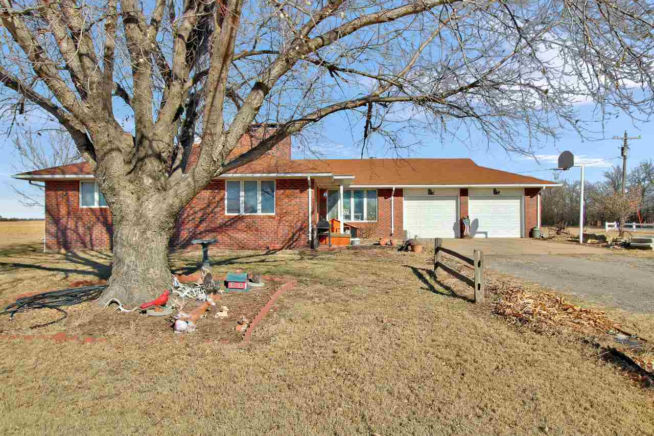 Country living at its finest in this all brick ranch style home close to Highway 50 and Arlington Road. Situated on 2.19 acres, this all electric home offers over 3000 square feet of living space with three bedrooms and two full baths. Cozy living room area with a wood burning fireplace (used as the main heating source during the cold months).  Large closets and lots of storage on both levels. Recently renovated kitchen and dining space, with custom cabinets and appliances that remain for new buyers. Versatile recreation room and nice main floor laundry. Full basement offering more family room space and option to have a kitchenette area plus large bonus room, bathroom and additional fireplace.  Oversized, attached two car garage, as well as a detached two car garage with shop area. Agricultural 3 stall building on the property currently used for parking,  previously used as cattle shelter. Decorative vinyl fencing on part of the lot, and large fenced area that could be used for horses or to add additional buildings.  Solid family home waiting for its next owners in charming community of Arlington.