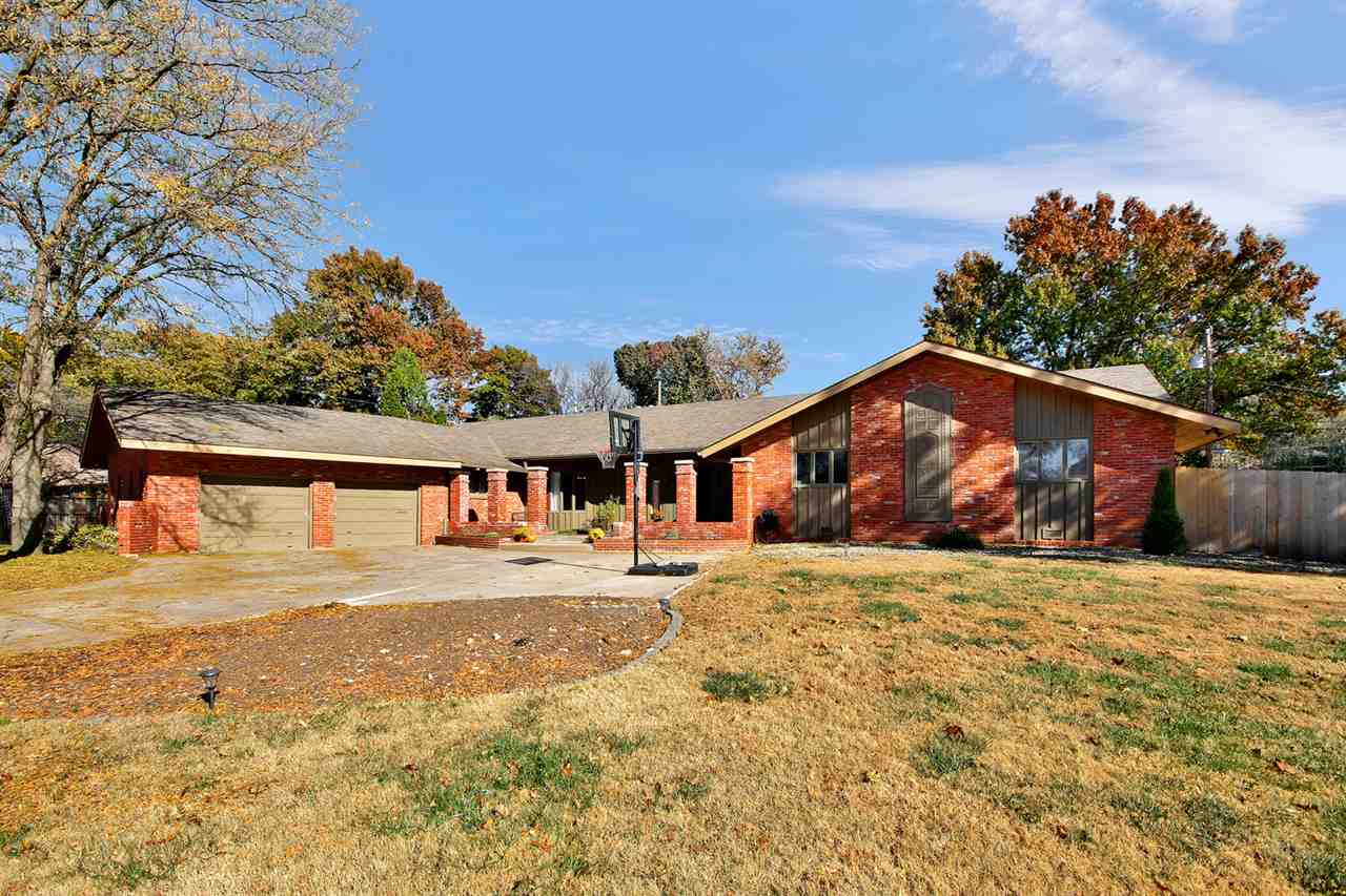 Situated on nearly a half-acre lot, this full brick recently remodeled home is what you've been wait