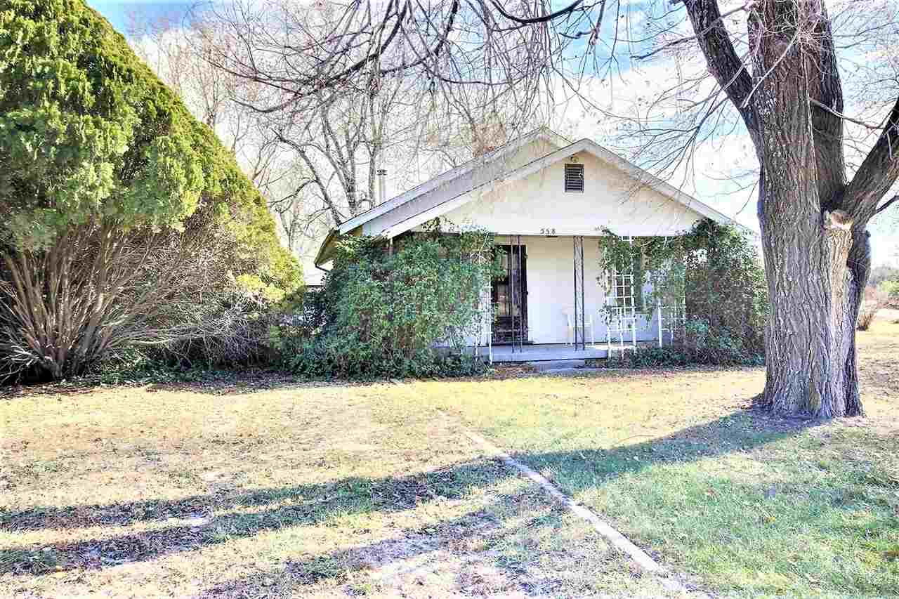 Country living close to town. This property has great potential! Great Location! 2 Garages one is bi