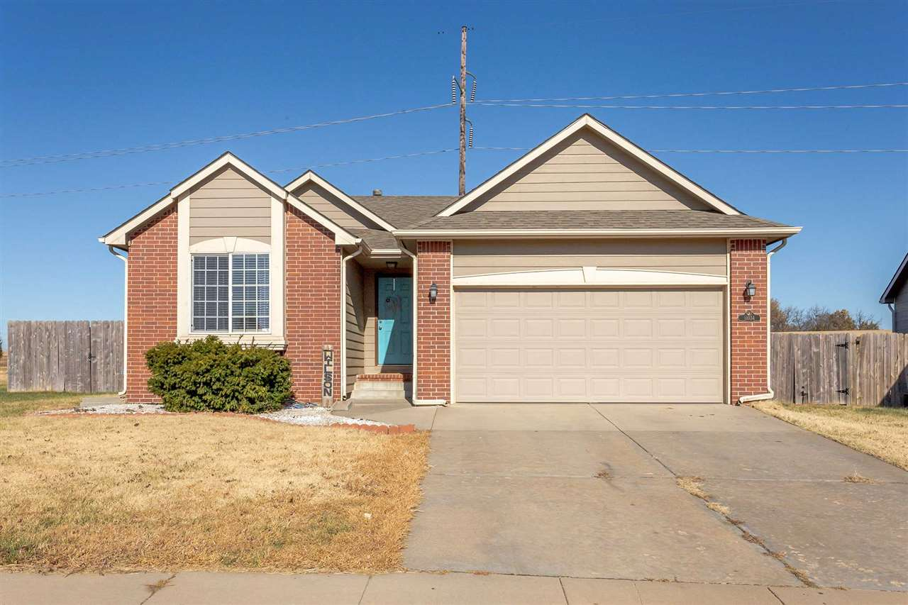 Say, HELLO to your new home! This three bedroom, two bathroom home is located just off of Kellogg an