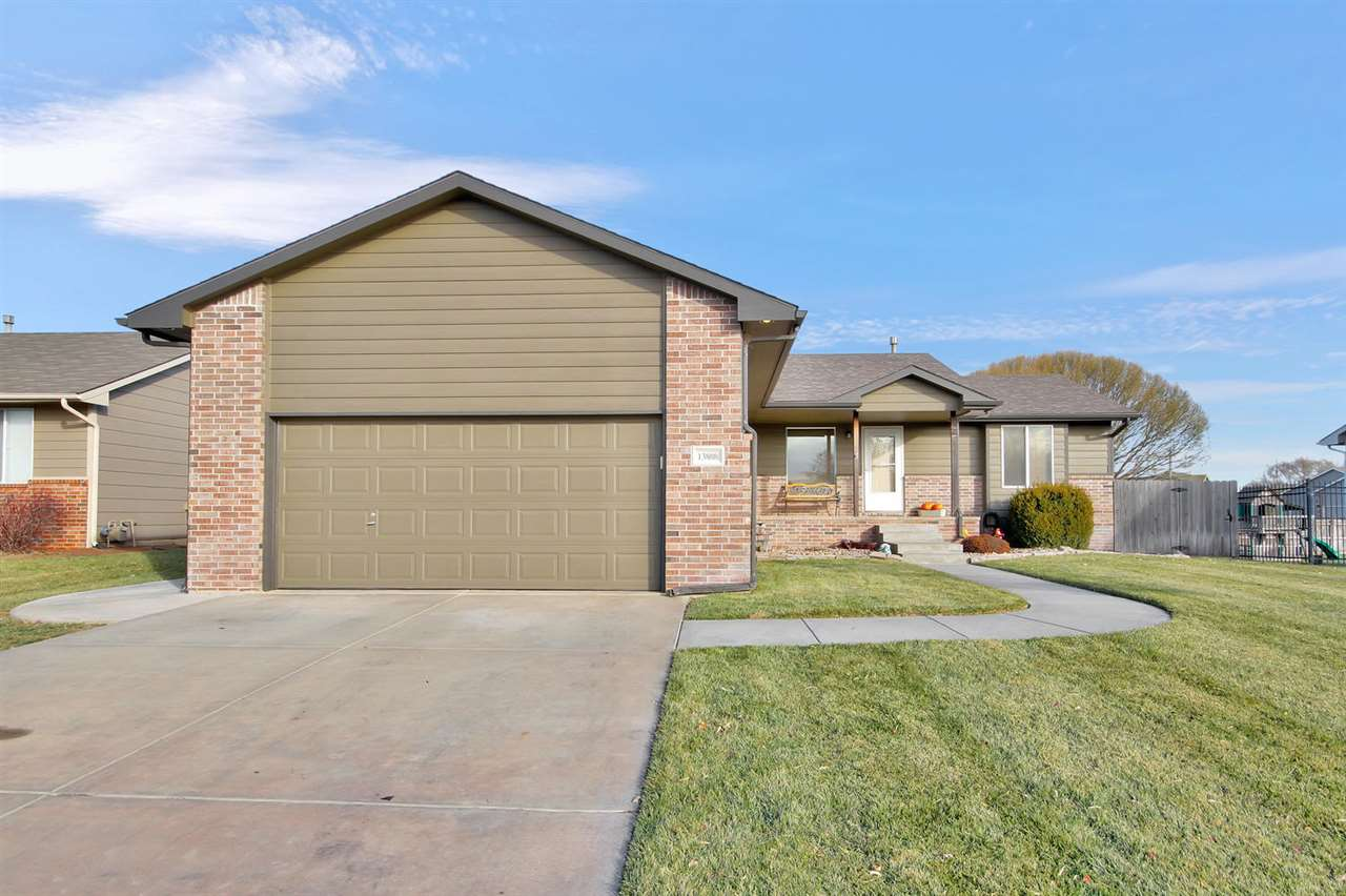 Don't miss your chance to view this beautiful home in the Maize school district!  This home features a very open split bedroom floor plan with a total of 3 bedrooms and 2 baths on the main level.  The kitchen has a generous amount of cabinets, eating bar and all appliances remain!  The entire home has new carpet and wood flooring has been installed in the dining and kitchen.  The basement is BRAND NEW!  Bar with wine/beverage fridge, huge family room and game room area, bedroom and full bath!  Gorgeous manicured lawn with sprinkler system, well and privacy fence for the kiddos and pets.