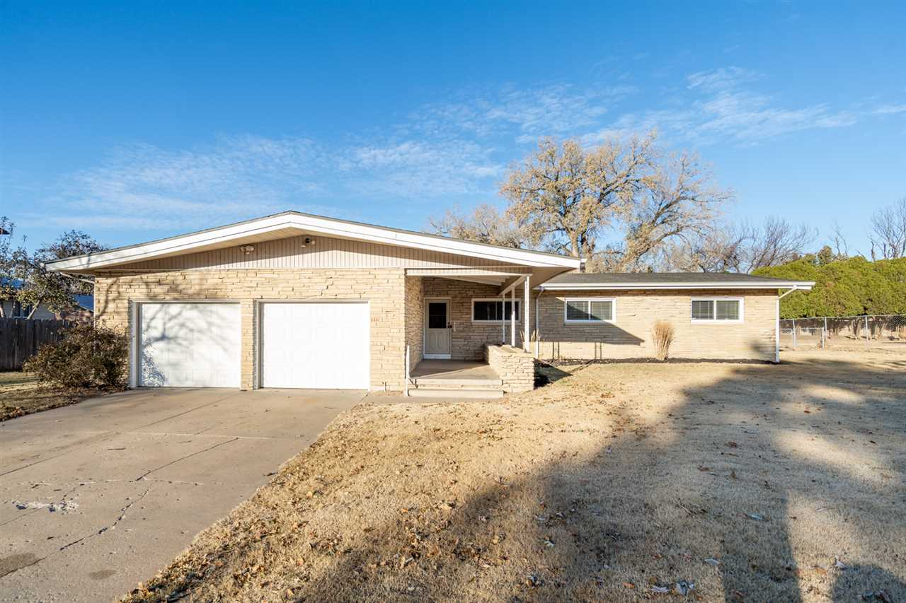 Gorgeous updated and charmingly unique mid-century modern ranch on a half acre lot!! The long covere