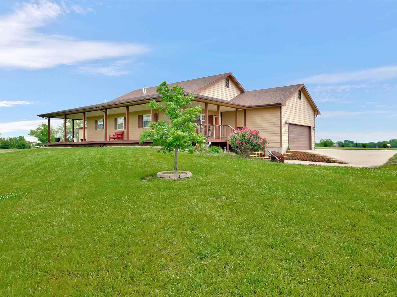 This beautiful home with detached outbuilding sits on almost 10 acres of freedom... also known as co