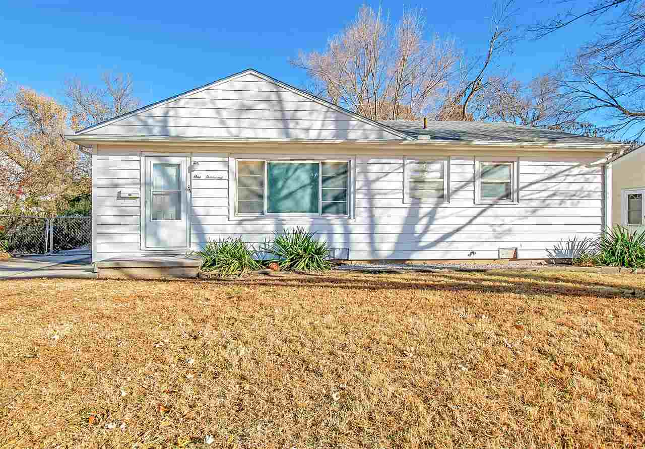 BETTER THAN NEW ... UPDATED EVERYTHING ... GREAT STARTER   Right across from the park, you have a gr