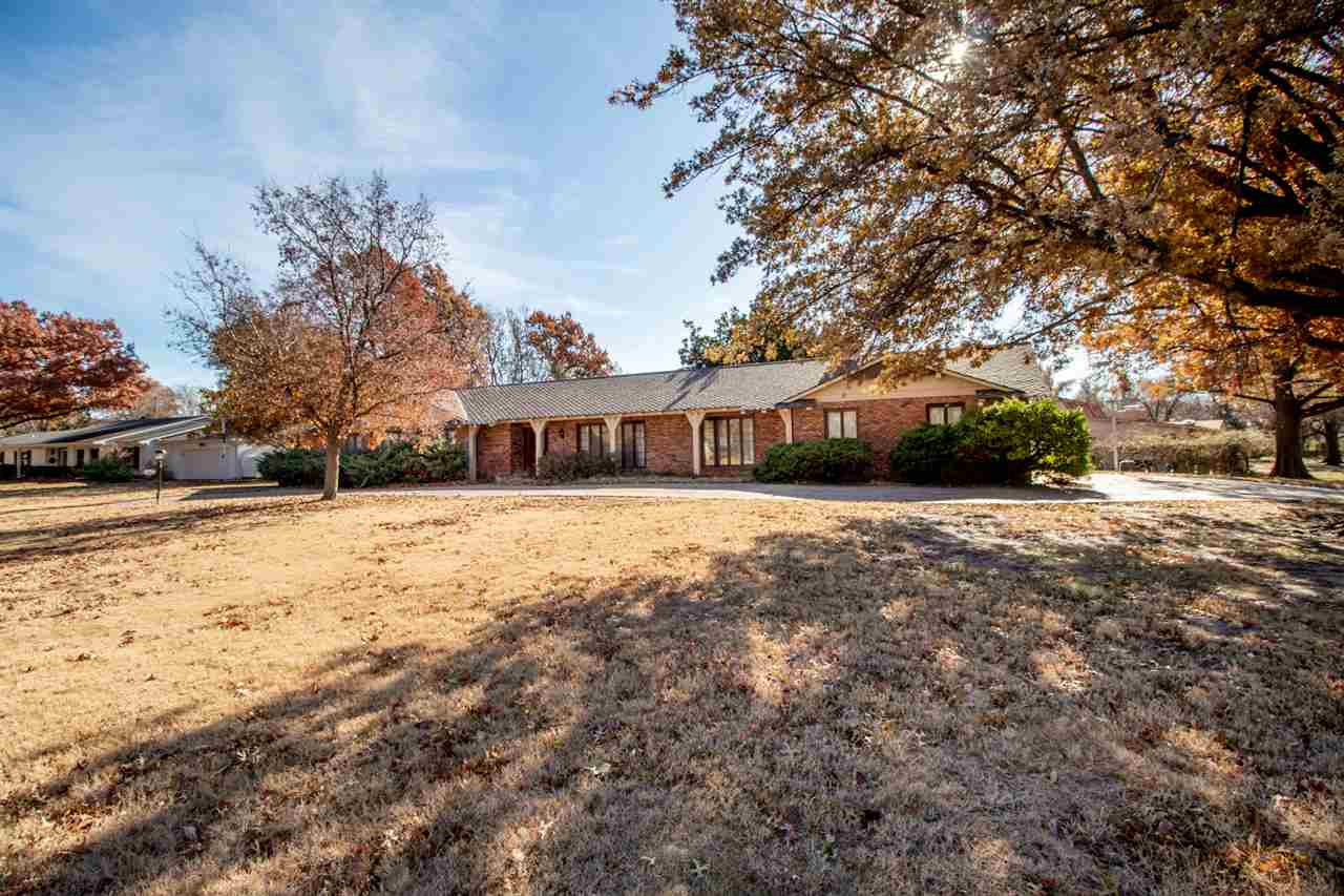 Charming ranch situated on almost a half of an acre corner lot complete with circle drive, oversized