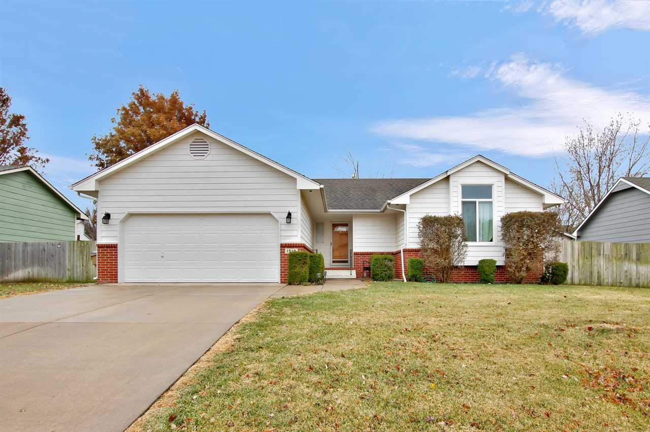 Welcome home to this 4 BR/3 BA ranch in the heart of Derby.  The 1300 sf main floor consists of a sp
