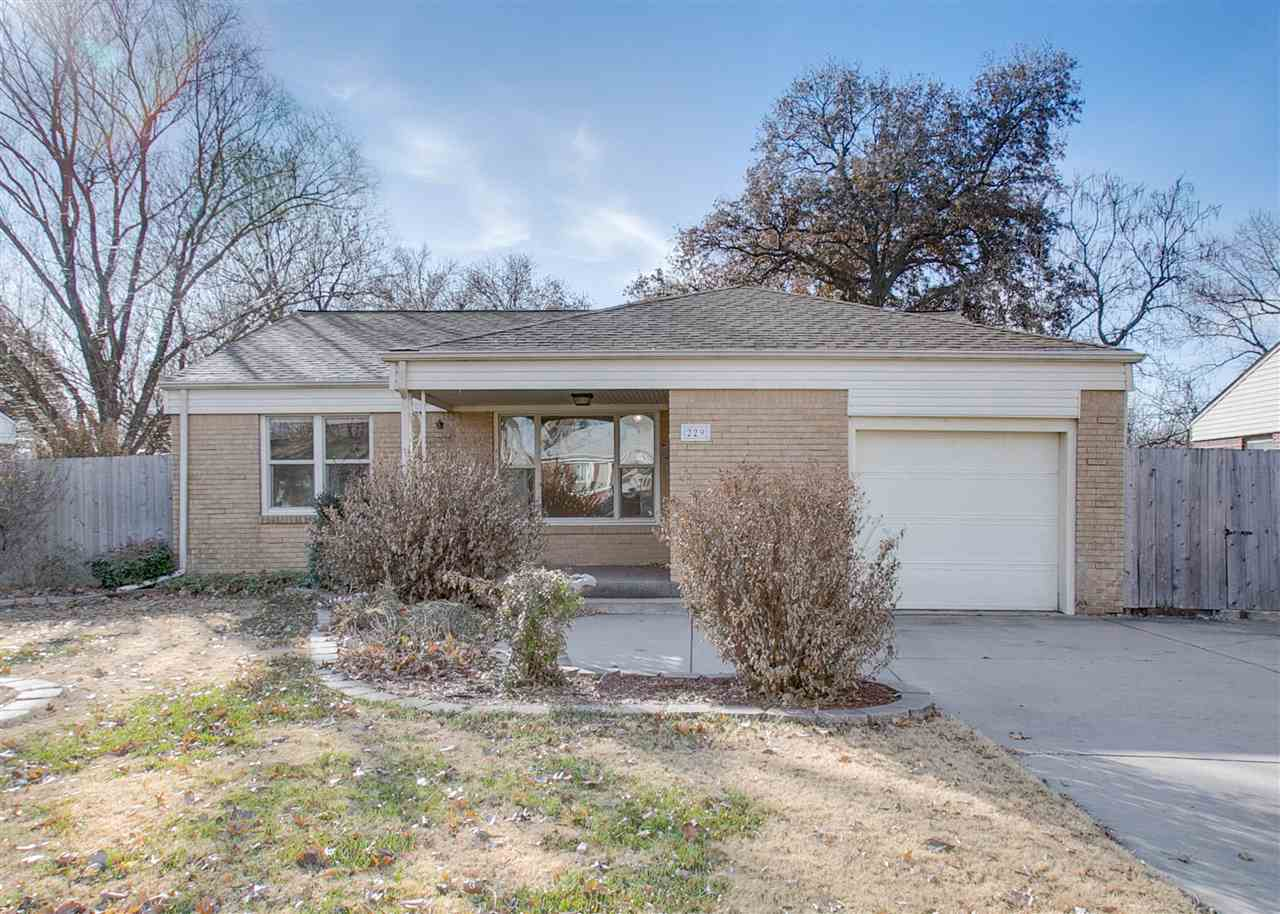 Well maintained full brick ranch with nice landscaping, irrigation well, covered patio, storage buil