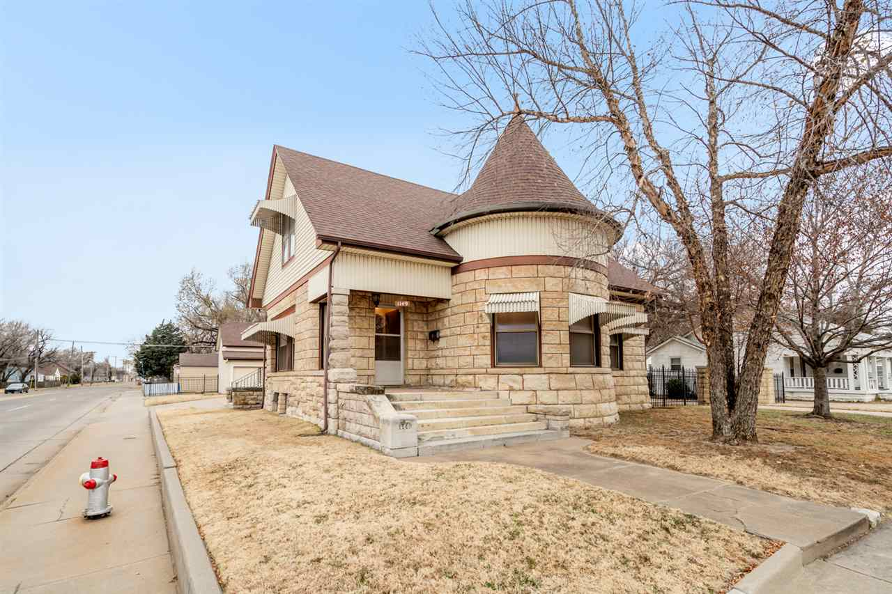 This Victorian charmer has an abundance of beauty!  Built in 1909, this stone home has a lot to offe