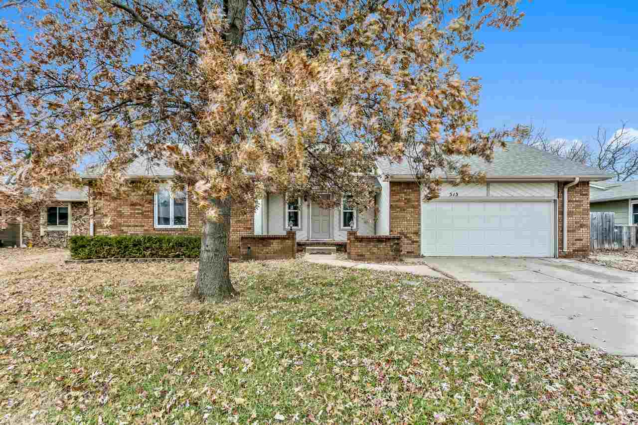 OUTSTANDING FAMILY HOME NESTLED IN A QUIET WEST WICHITA NEIGHBORHOOD. CHARMING FRONT ENTRY WITH BRIC