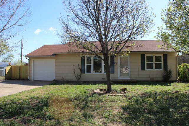 Charming move in ready in  South Wichita.  This home has been recently painted, Newer Vinyl Windows,