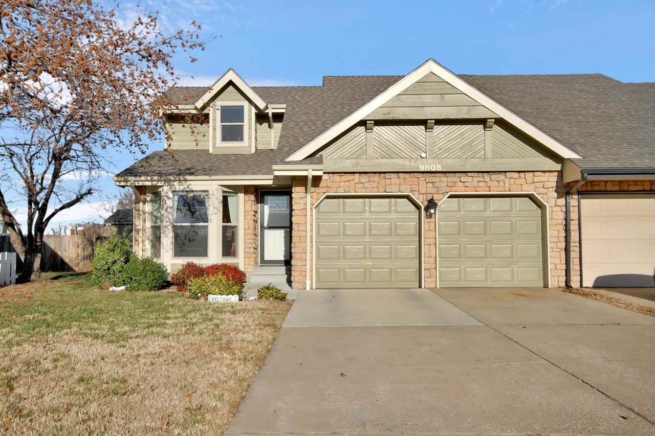 Great twin home on a quiet cul-de-sac, this is a must see! Attractive stone front curb appeal enhanc