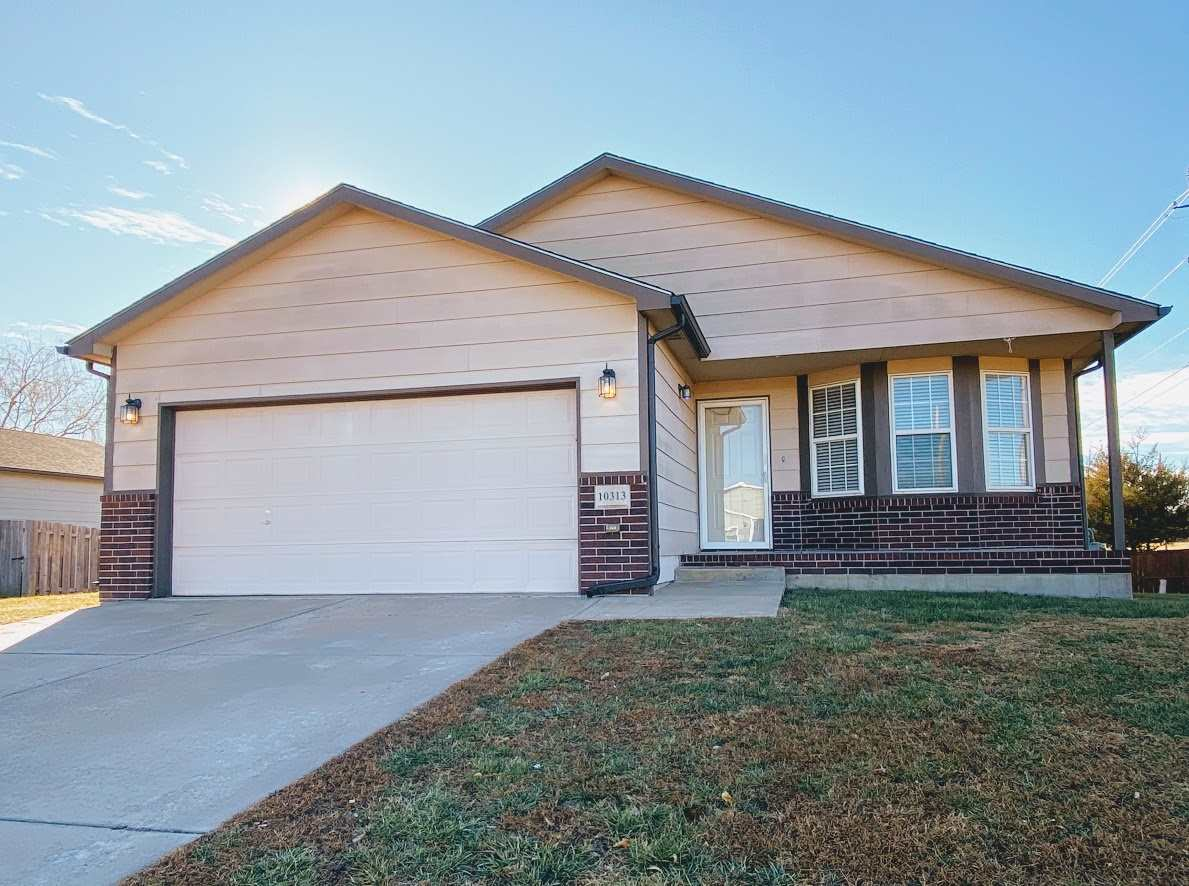 This clean and comfortable home in the Goddard school district is move-in ready! The sunny living ro