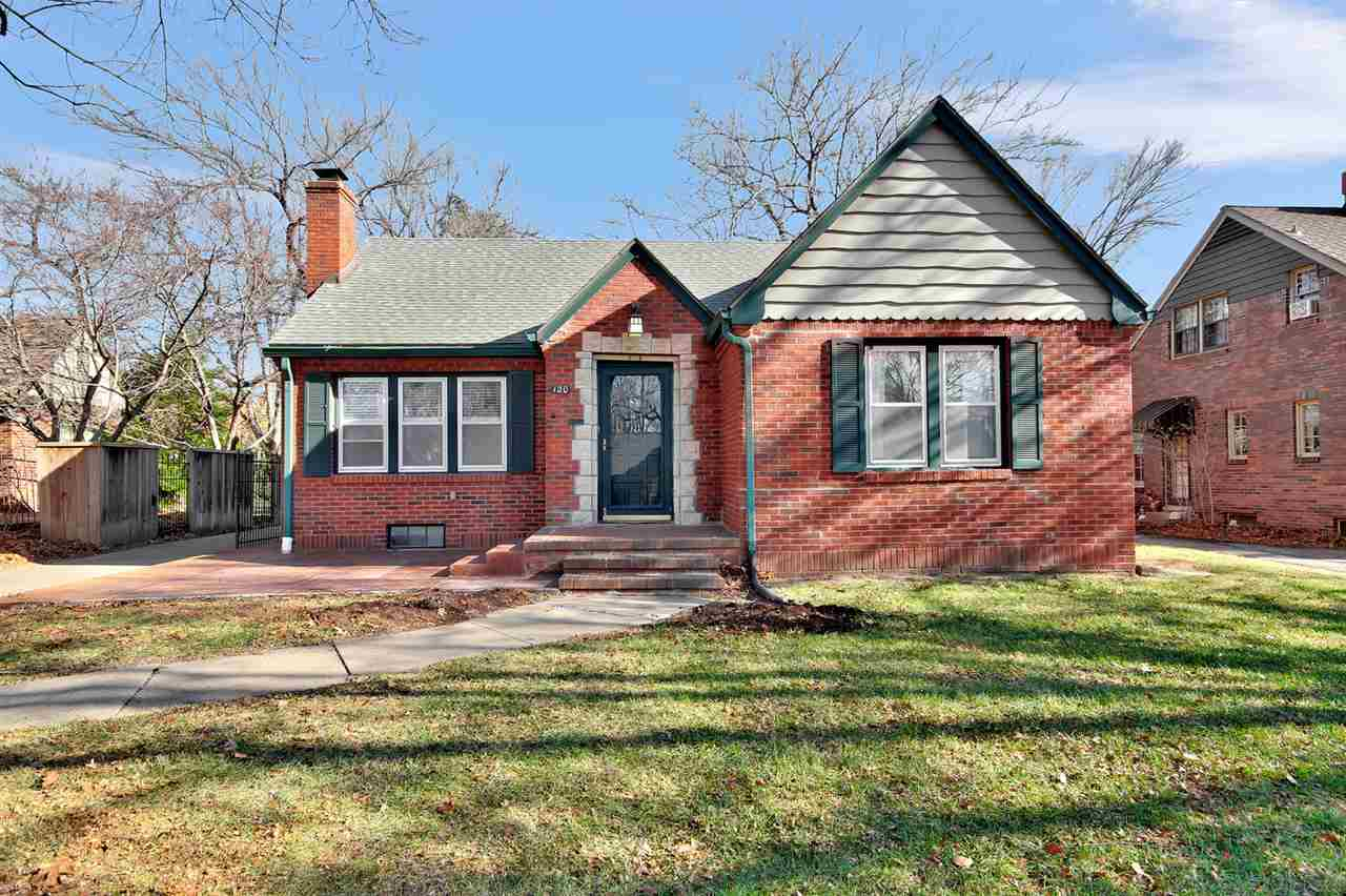 You will love this Crown Heights charmer! An all brick exterior and new stained front patio welcome