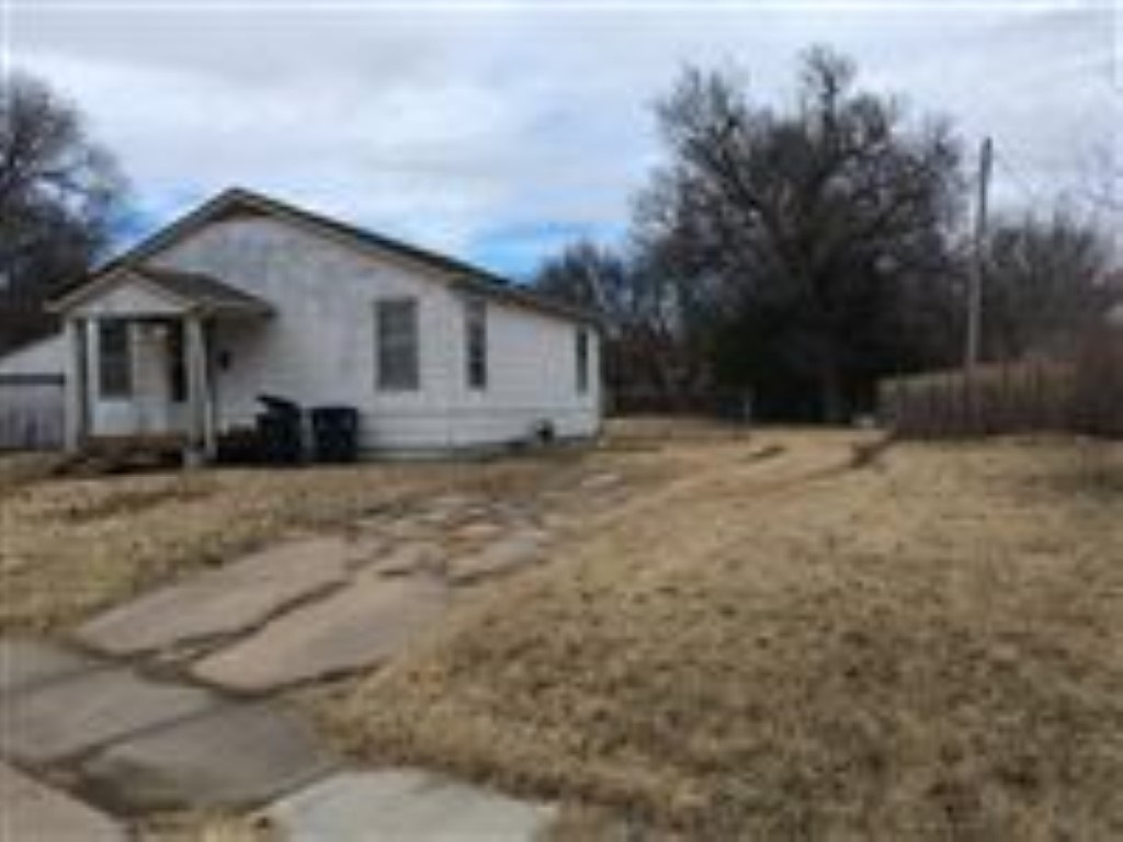 Two bedroom, one bath, two car detached garage. Currently rented out for $600 per moth. Tenants request 24 hour notice for showings. Buyers are to verify schools and all courthouse records, such as taxes. All information is deemed reliable, but not guaranteed.