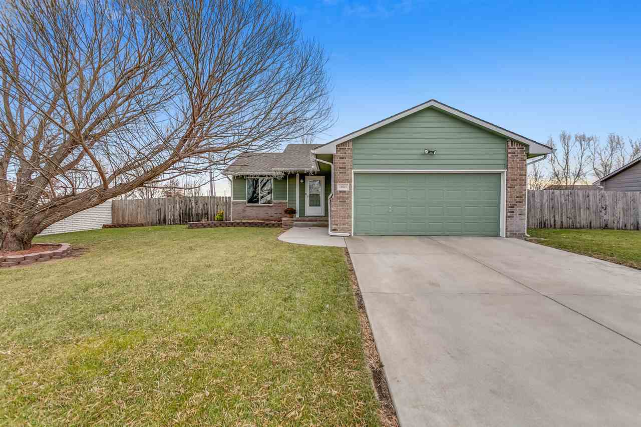 WELL MAINTAINED RANCH IN THE MAIZE SCHOOL DISTRICT. OPEN CONCEPT MAIN LIVING SPACE FEATURES WOOD LAM