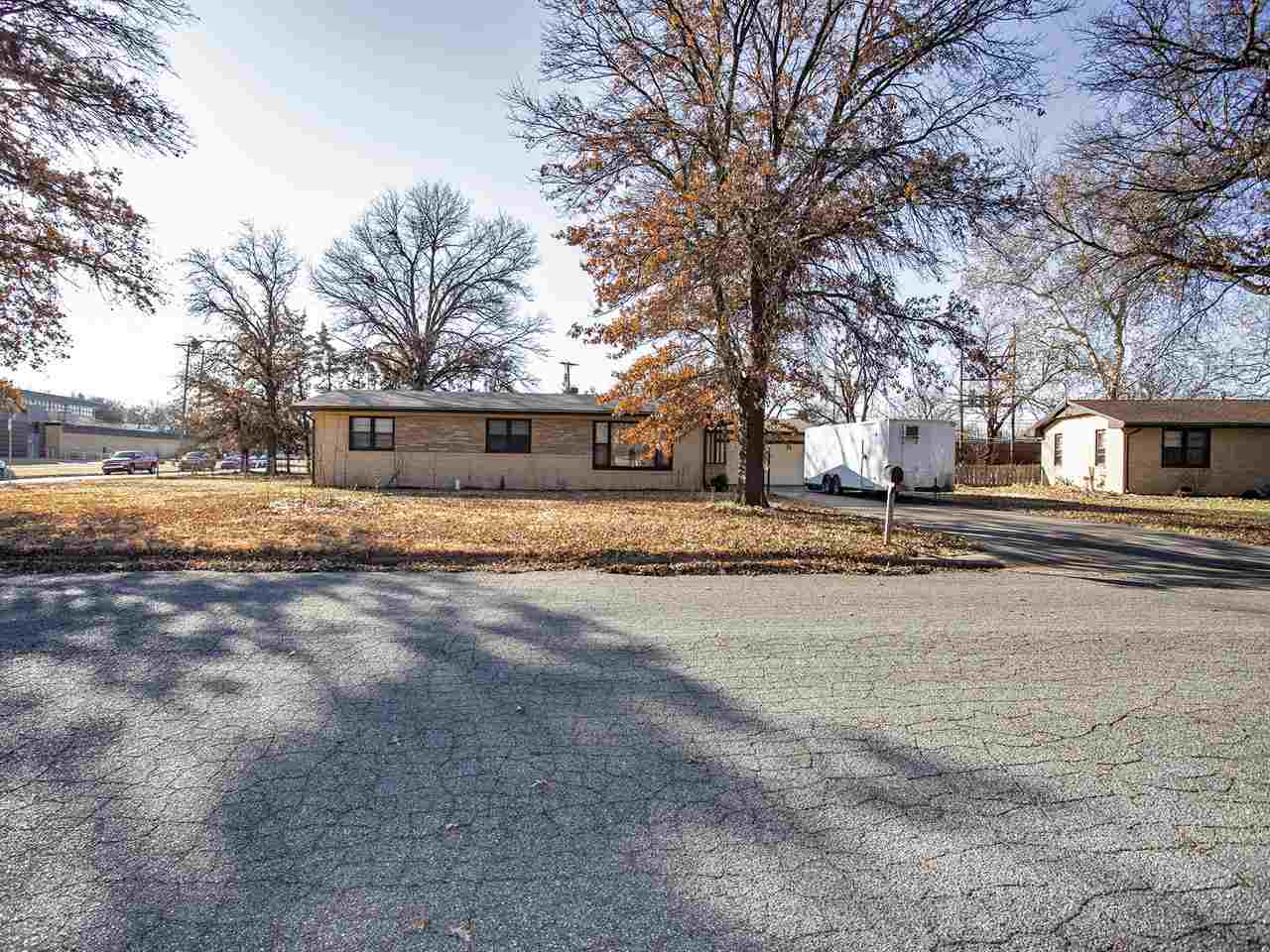 You will love this large 1/3 acre corner lot that features a long driveway with an oversized 2-car g