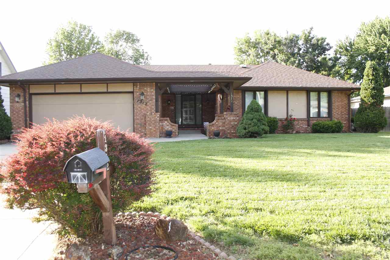 Located in a quiet and safe neighborhood, this one owner home has been very well maintained.  It has great architectural beams and a wood burning fire place with a gas starter in the large living room.  The home has a new roof (11/2019).  There are 3 bedrooms and 2 bathrooms on the main level, a wonderful kitchen with lots of storage, a dining room with an additional eat at bar area.  There is a great sun room with access from the dining room.  The laundry hookups are on the main level.  The bathroom has a fun sun tunnel and an over sized vanity. The master bedroom includes a bathroom with a shower and a nice walk in closet.  The basement has three daylight windows, a bonus room which was used for an office and a nice storage area, a family room with a wood burning fire place with a gas starter and a very nice custom wet bar area.  The bonus room/game room is just the right size for a pool table or table tennis.  There is a guest bathroom with a shower.  The bedroom in the basement is large and has an over sized walk in closet.  The back yard is fenced and has a nice storage shed.