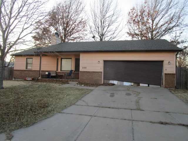 3 bedroom 2 bath ranch home in the desirable Maize School District. Located on a corner lot, this ho