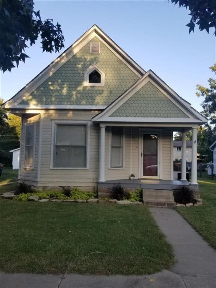 Charming two story in a great location! From first glance you will love the curb appeal and charm of this 3 bd, 1 bath property! Inside you will immediately appreciate the original hardwoods that have been refinished! The roof is just 3 yrs old, new carpet, fresh paint, and updated bathroom! You will love the large living room and spacious eat-in kitchen! Outside you will find fenced in backyard and two car garage! Call listing agent today to schedule a showing!