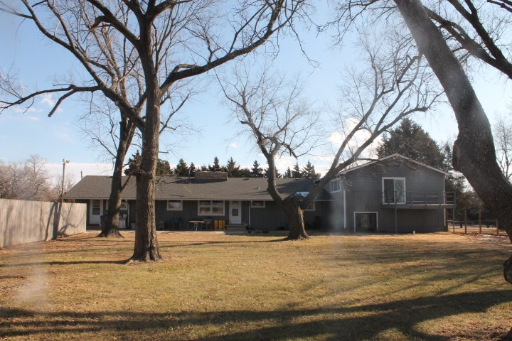 Nearly 3 acres inside the city.  New roof, newer heat & air.  2 wells, newer water heater.  Spacious