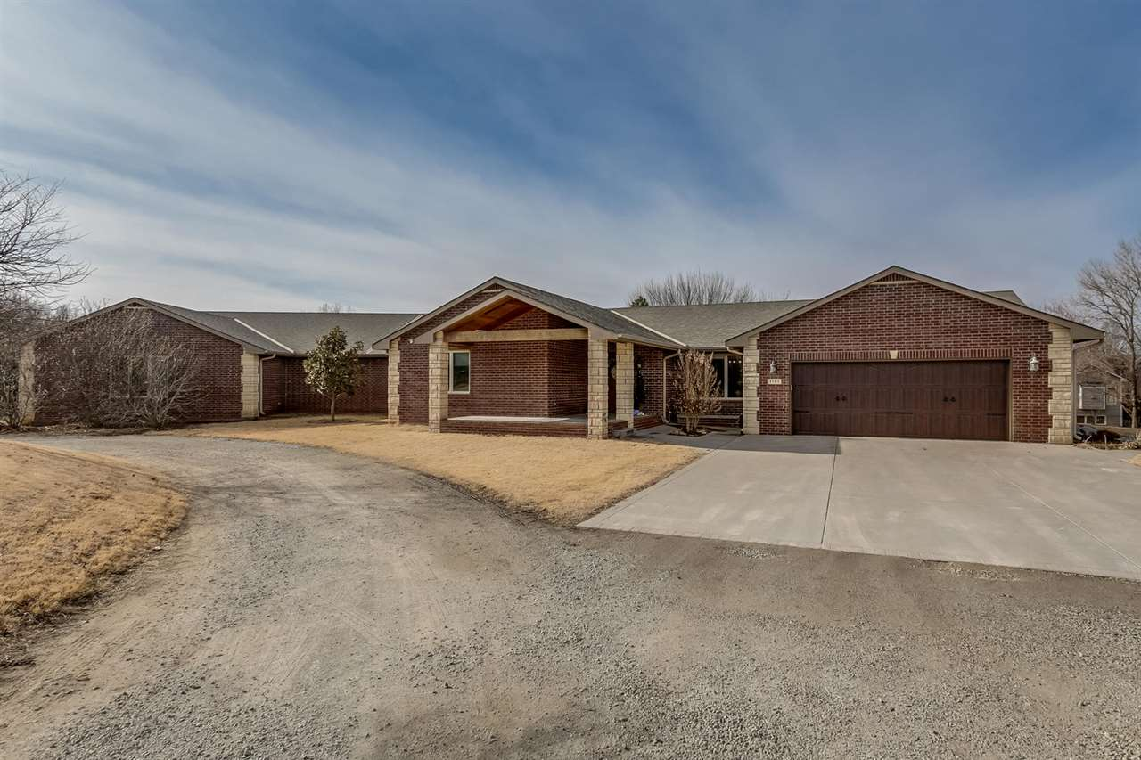 Gorgeous Custom Built Builder's Home on 1.44 Acres in Derby with a 2543 Square foot shop with 18 x 13 Overhead Doors and  Garage with an Office, Full Bath, kitchenette and Loft!  Garage is 2 x 6 insulated R-19 and heated and cooled.  Home was originally built in 1974 and striped down to the concrete and totally rebuilt in 2010 with new framing, wiring, plumbing and Sewer.  5 bedrooms all with walk in closets ( 2 main Floor Masters with private baths).  4.5 Bathrooms.  1942 Square feet main floor with Wood Floors and Granite.  Full Finished Basement.  Inviting Covered Front Patio and Circle Drive.  Main Floor and Basement Laundry.  Entertaining 12 x 20 Covered Patio for Grilling and Relaxing.  Home is all Electric with Blown in R 38 Attic and R 15 Walls.  Home has a Heat pump plus a Pellet Furnace for Low Winter Bills.  400 amp Electrical Service.  Large Back pack Mud room off front Garage Perfect for unloading.  Nice Magnolias, Oaks, Birch and Maple Trees.  Custom Tree house/Forts.  Andy Mackey is scheduled to Professionally paint exterior