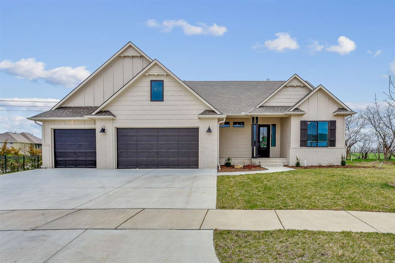 Incredible split three bedroom ranch with a full bath for bedrooms 2 and 3 and a huge upstairs BONUS