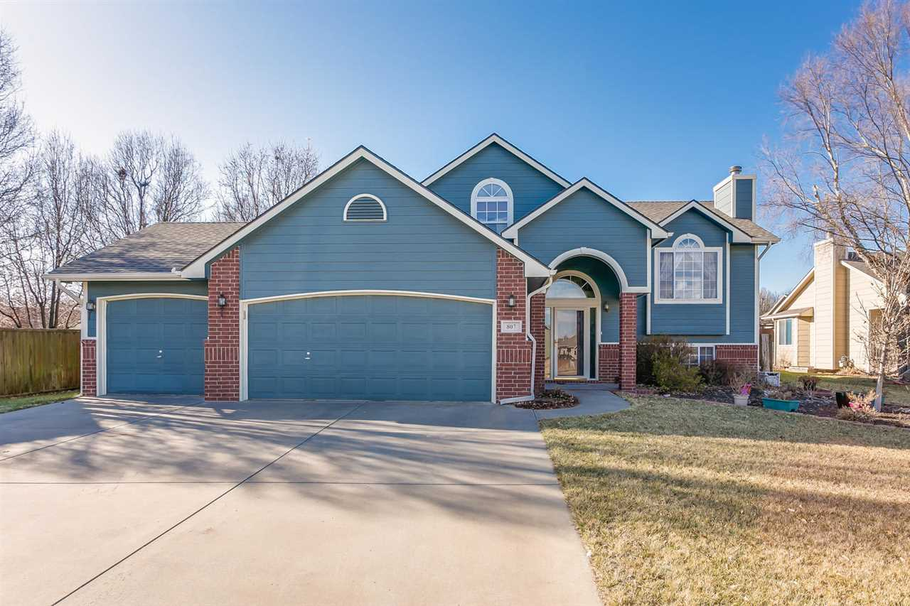 Great Family Home centrally located in the heart of Derby!  Easy Walk to the High School, Water Park, Shopping and Restaurants.  5 bedrooms, 3 Full Bathrooms, 3 Car Garage.  Full Finished Basement with a 2nd Fireplace and Wet bar.  Nice Dine in Kitchen walks out to a composite Deck, Fenced yard, Gazebo and Water Feature.  Freshly Painted Exterior and Roof 1.5 years old.  New Carpet being installed on all the stairs, 4 of the 5 bedrooms (Master has wood laminate), all green carpet will be replaced.