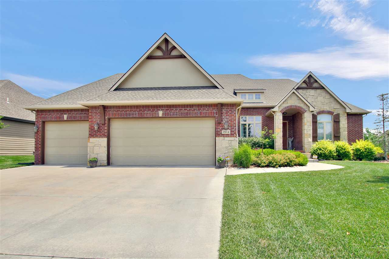 You will love coming home to this warm and inviting former model complete with lots of upgrades and
