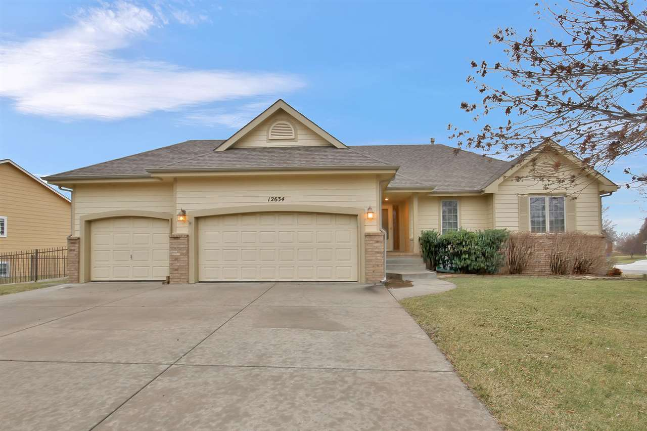 Move in ready, 3 bedroom, 3 bath home with 3 car garage in desirable Woodland Lakes addition.  This