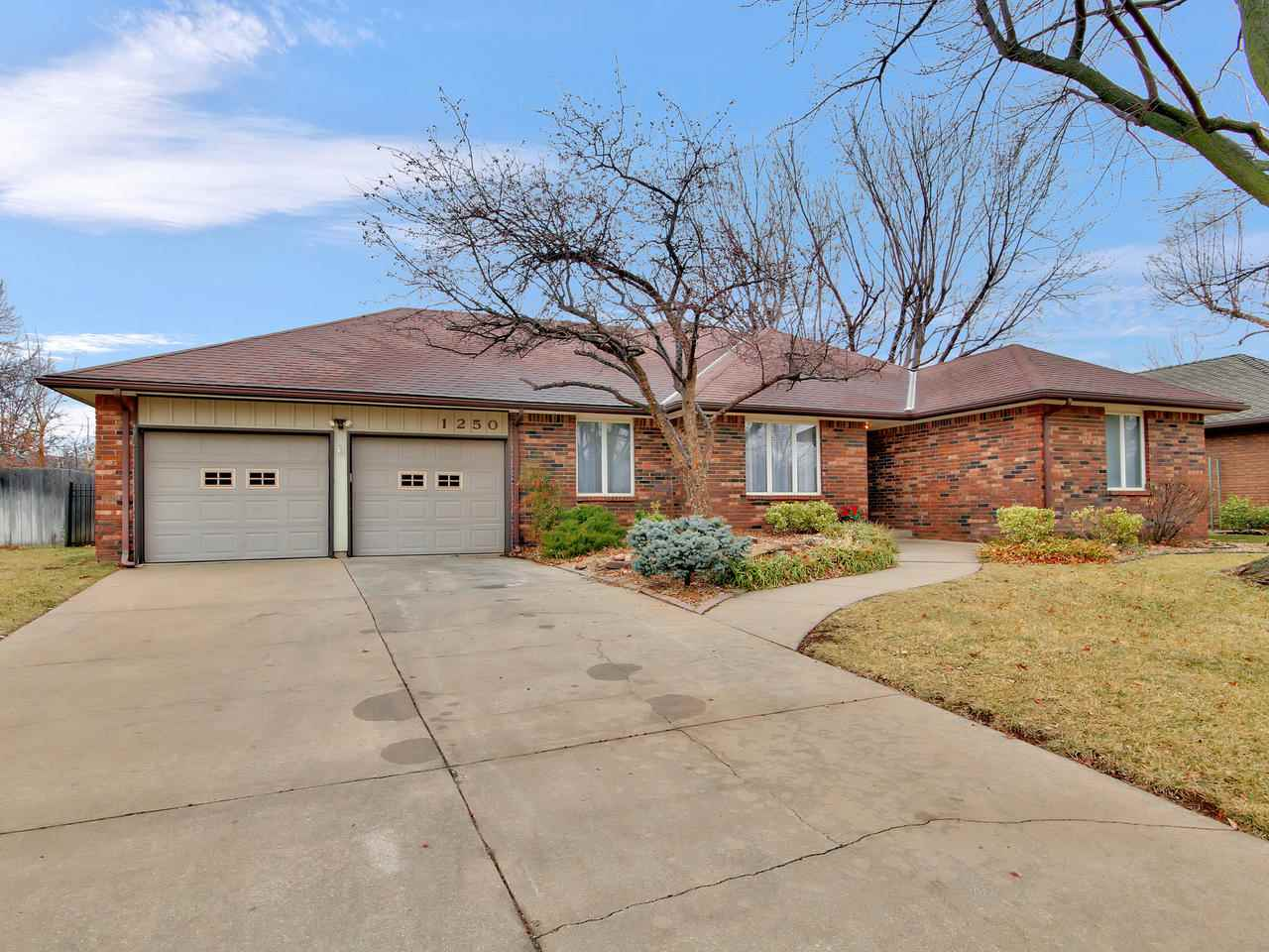 Spacious brick ranch almost 3,000 sq. ft. on quiet cul-de-sac in a lovely Derby neighborhood! Granit