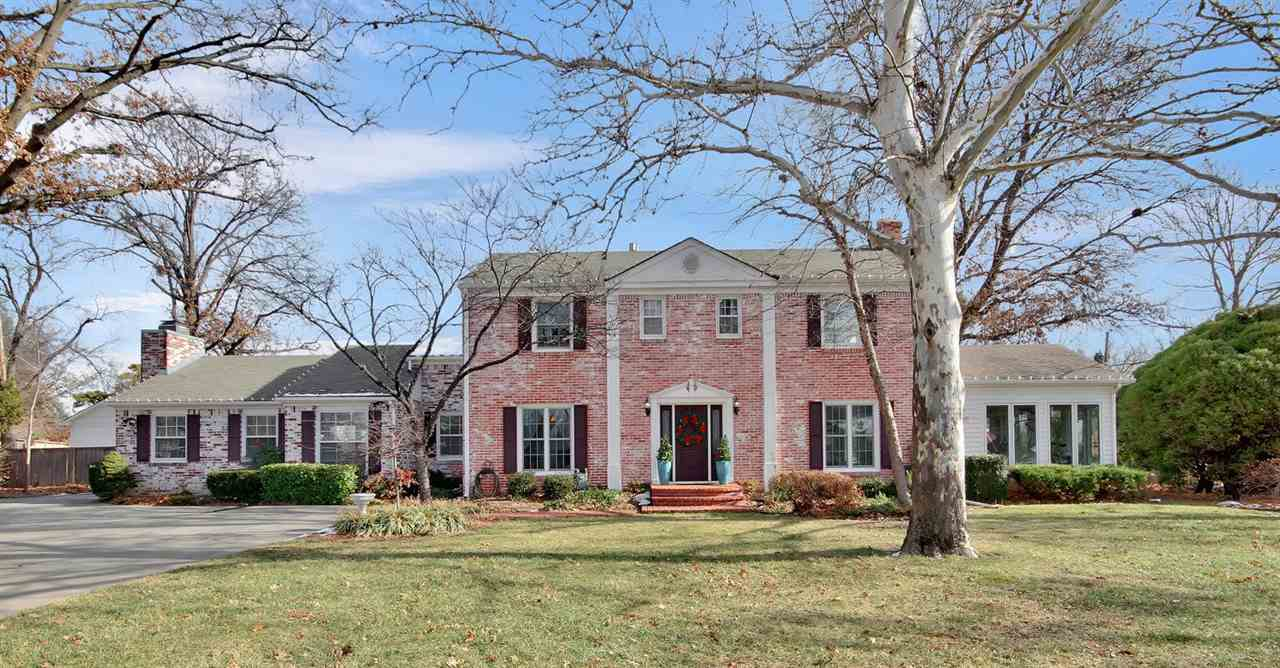 Welcome home! This stately 1-1/2 story brick colonial, nestled on a 0.58 acre lot, is immaculately m