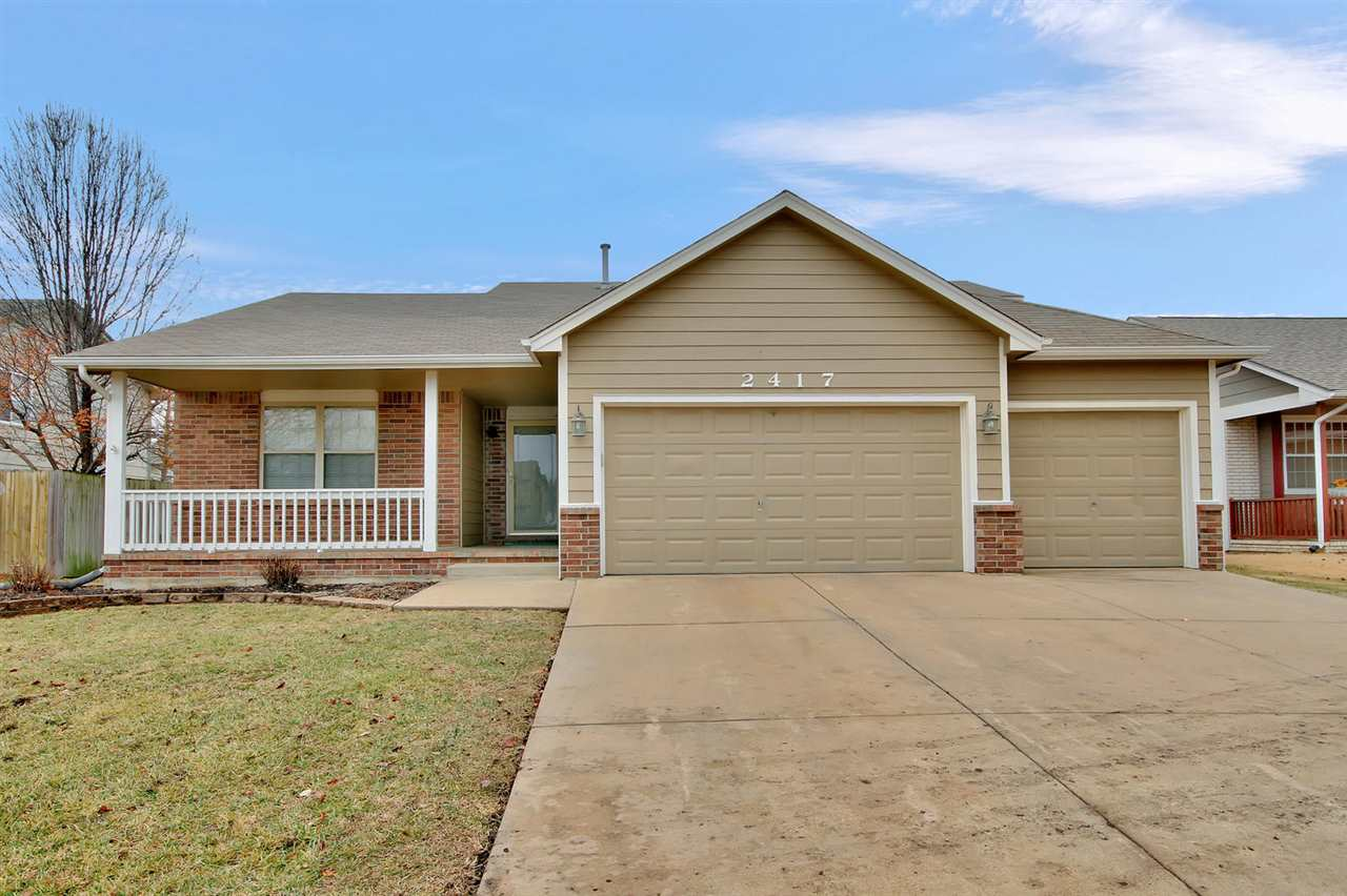Lots to love in this spacious 4 bedroom, 3 bath home and 3 car garage!  With 3 separate living space
